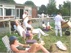 Spectators outside the Village Hall